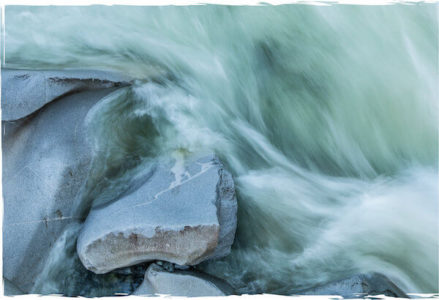 photos of water running on rocks